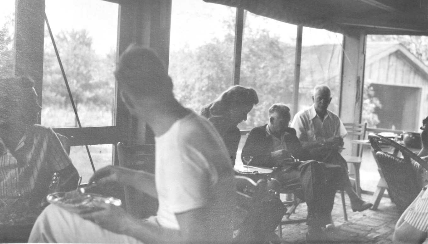 Burns family gathering in screened porch