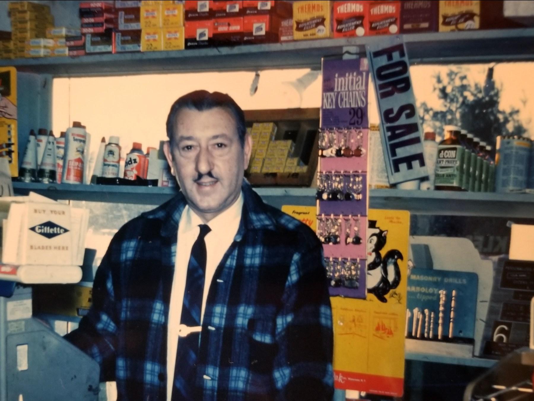 John DuCett behind counter