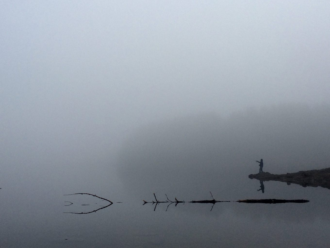 Reservoir fishing in the fog, Burlington MA. Photo credit: Robert Fahey