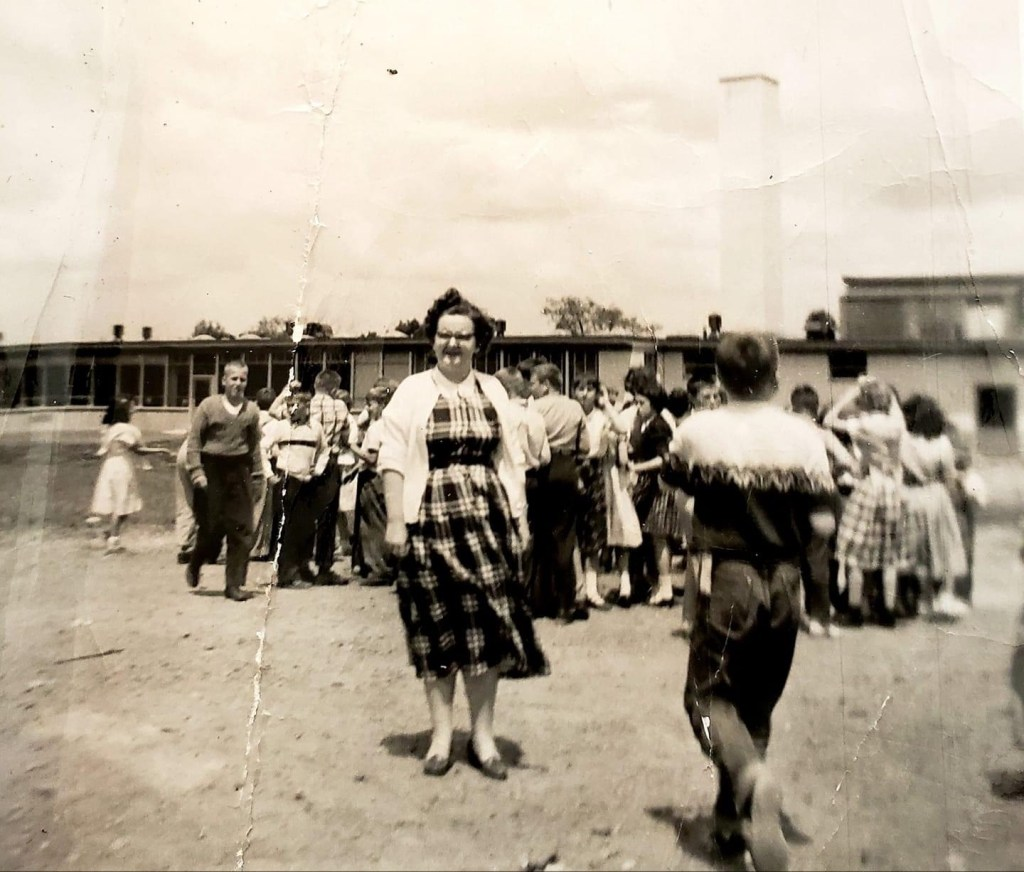 Teacher Jane Skelton behind Memorial School c. 1955, Burlington MA