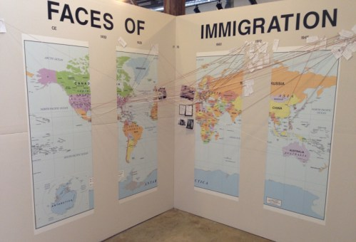 Faces of Immigration installation at ATHICA, on view through May 28.