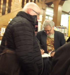 John Bolland, signing a copy of his book, Fallen Stock