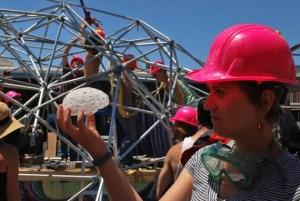 Natalia Bilenko holds a model of her brain in front of Dr. Brainlove. (photo: Asako Miyakawa)