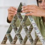 woman-stacking-money-in-pyramid_web