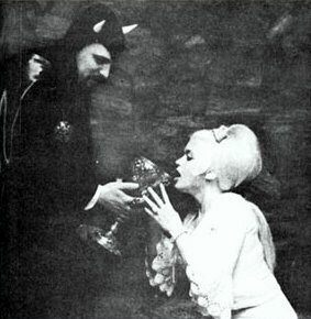 "Jayne Mansfield takes the ""sacrament"" from Anton LaVey"