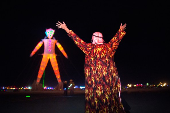 Crimson Rose signals The Man. Image: John Curley, burningman.org. Used without permission for non-commercial, educational, and discussion purposes under the Fair Use provisions of the Digital Millenium Copyright Act