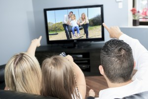 dreamstime_m_51039337 family points at tv pictures