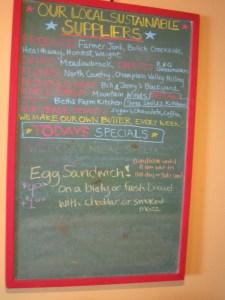 Blackboard menu listing local suppliers