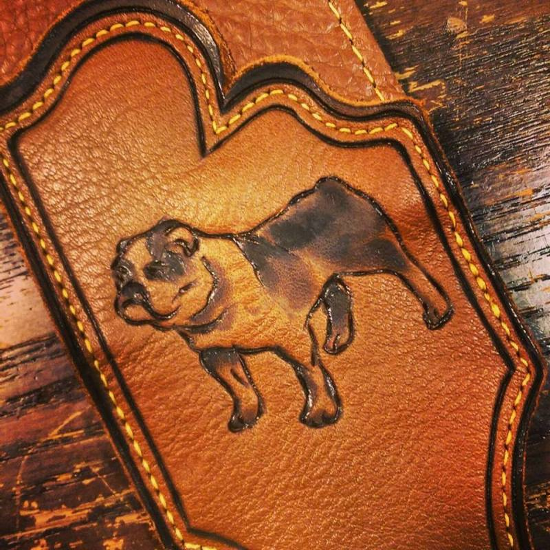 english bulldog pet portrait hand engraved on brown leather guitar strap