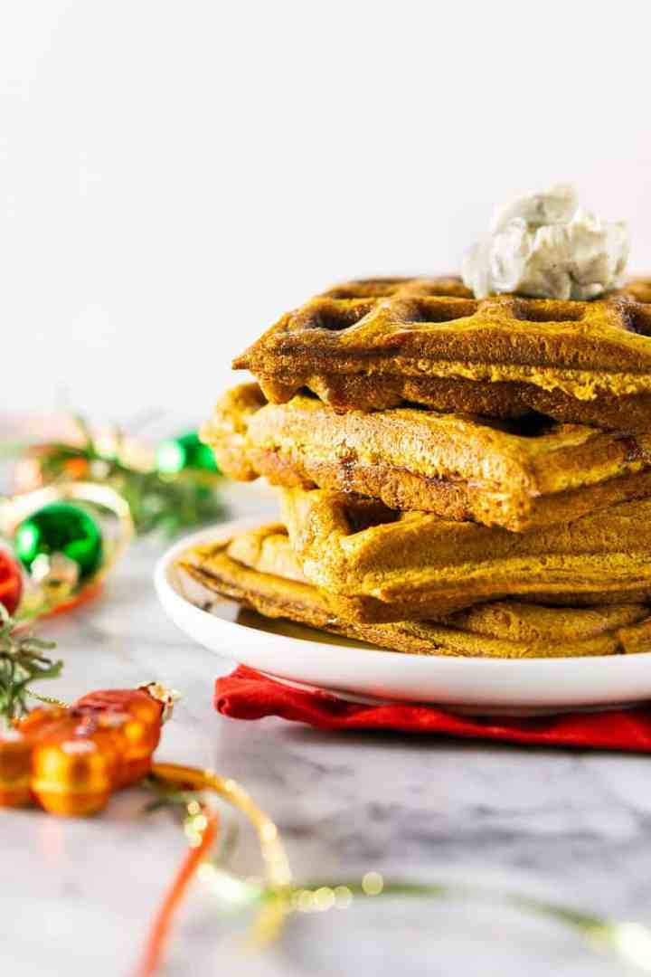 A side view of a stack of gingerbread waffles.