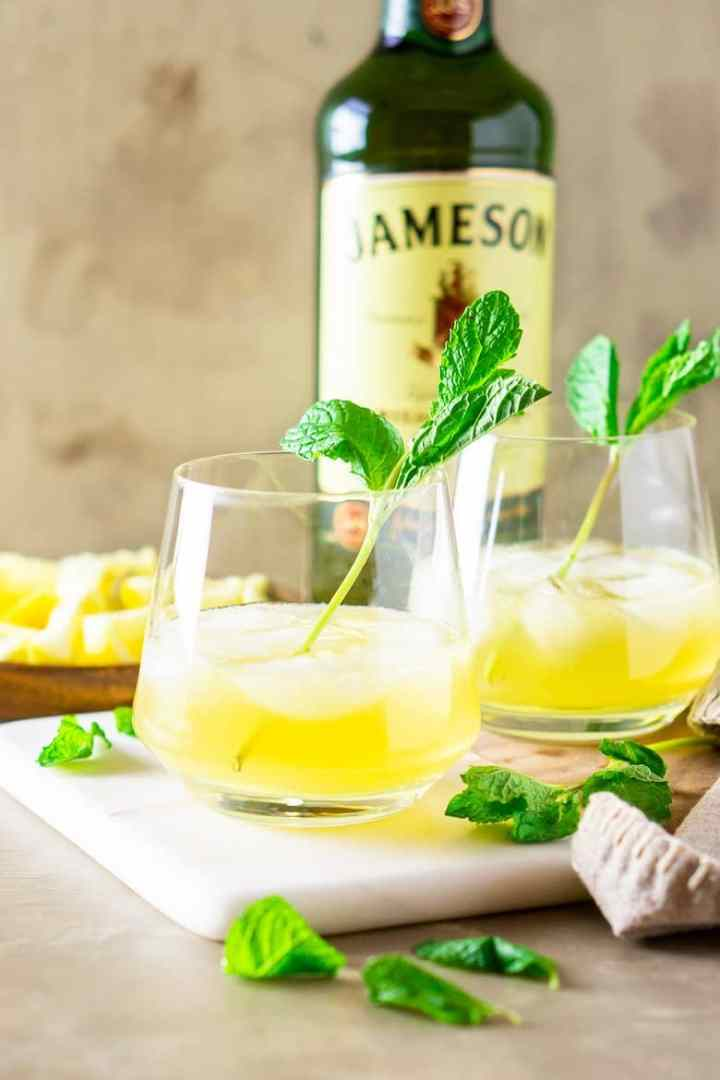 A bottle of Jameson with two Irish whiskey smashes