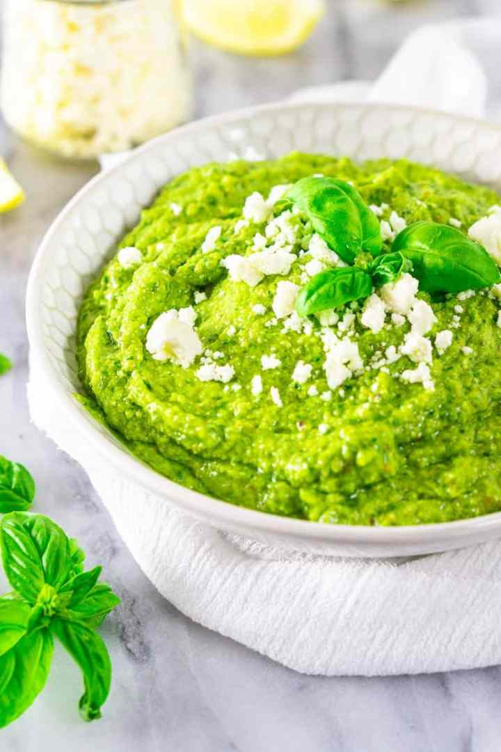 A bowl of avocado pesto blended smooth.