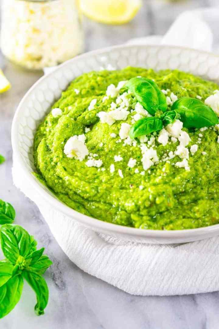 A bowl of avocado pesto blended smooth.