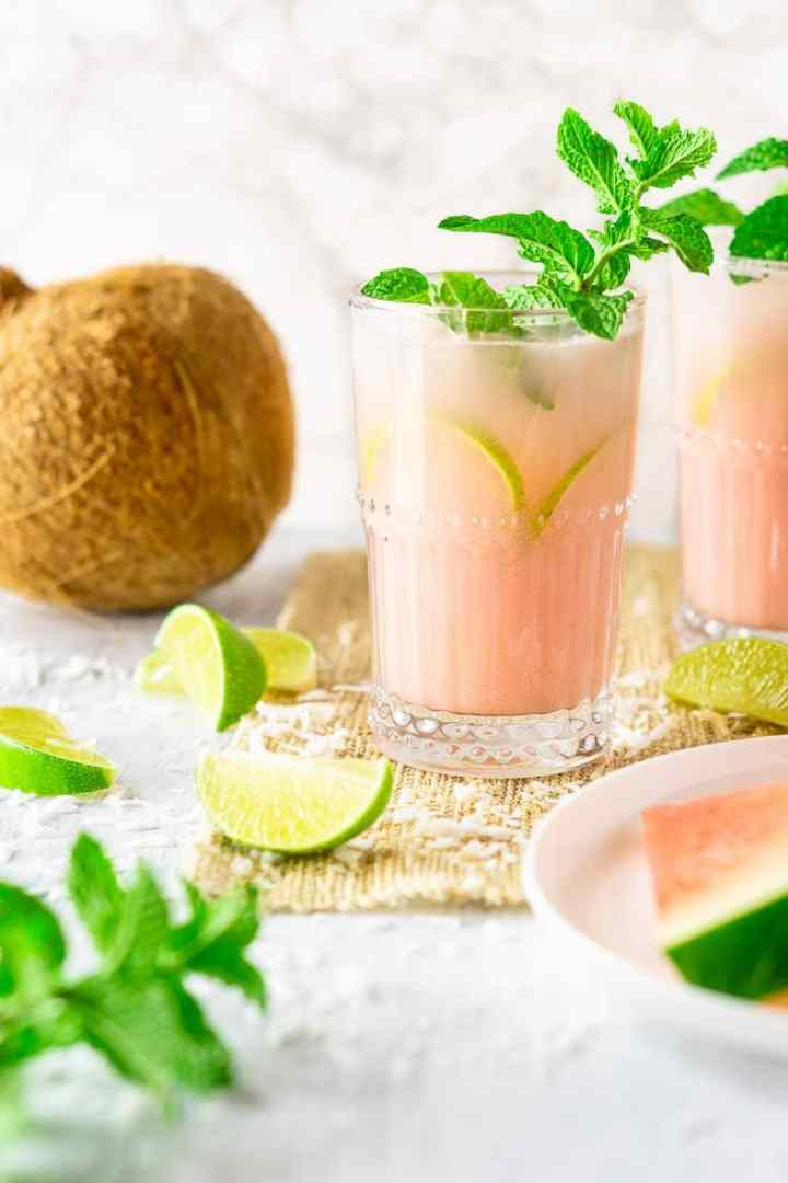 A coconut-watermelon mojito on a summery placemat.
