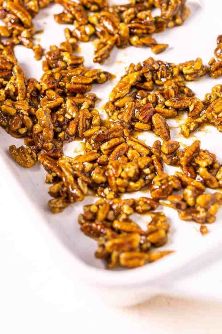 The candied pecans before cooked in a baking dish.