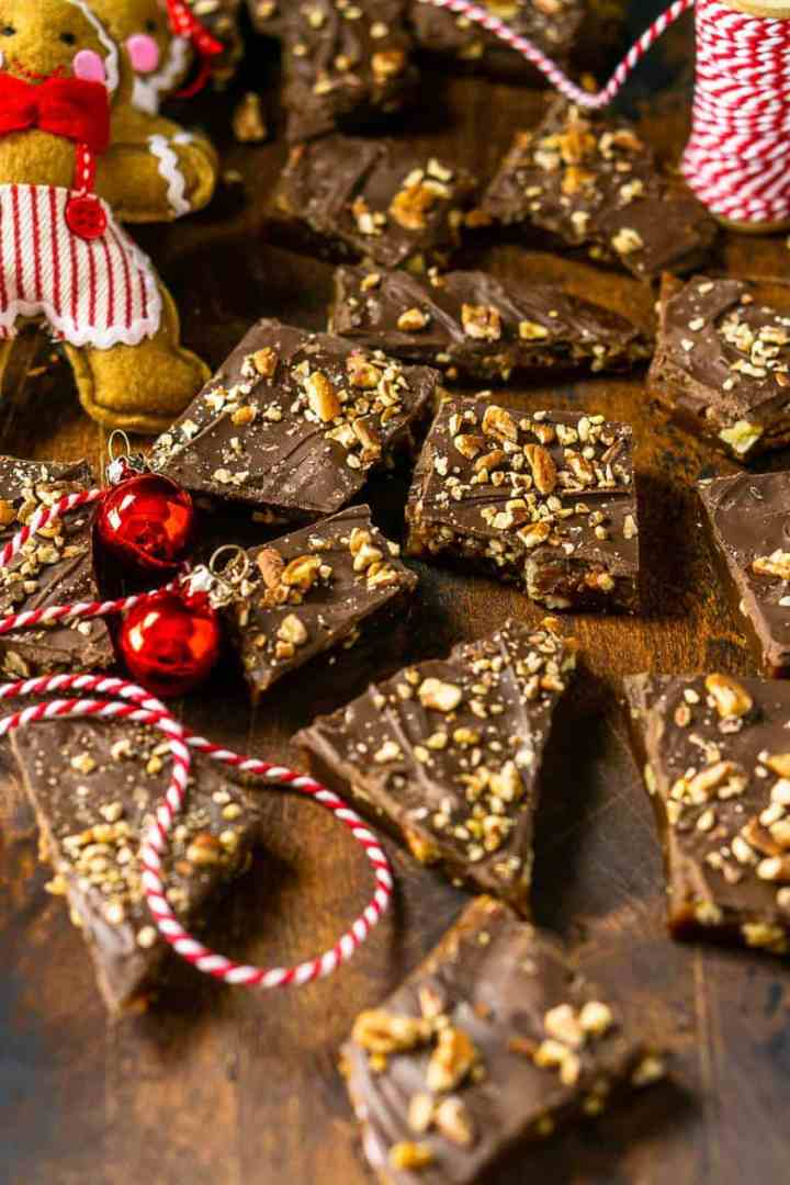 Gingerbread toffee on a wooden board with a red and white rustic string.