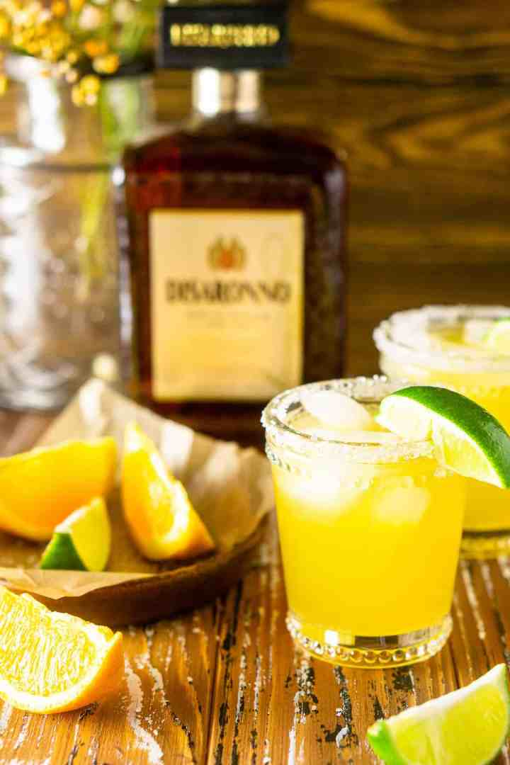 An Italian margarita on a wooden board with citrus slices.