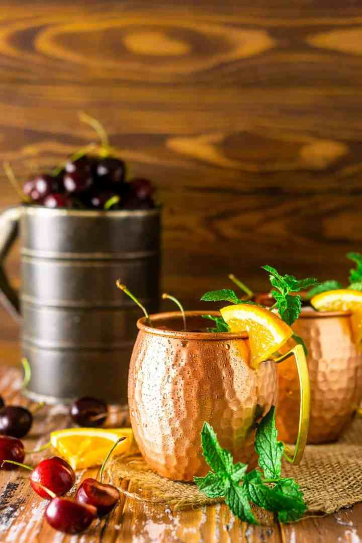 Two cherry-orange Kentucky mules with mint, cherries and orange slices.