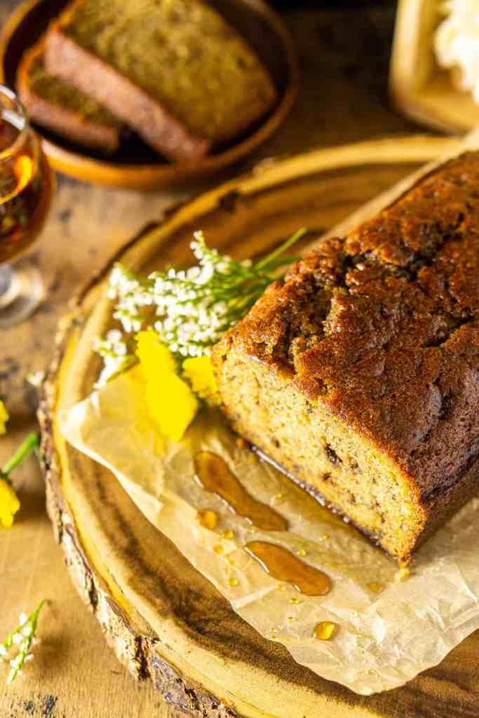 An aerial view of the banana bread with a drizzle of maple syrup around it.