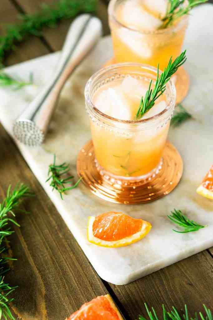 An aerial view of two rosemary-grapefruit spritzers.
