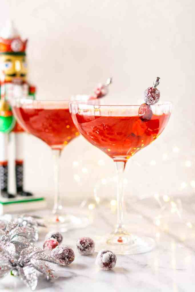 Looking straight on at a Sugar Plum Fairy Martini with lights and Christmas decor.