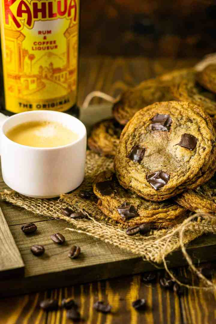 The espresso and Kahlua cookies on wooden tray with coffee beans around it.