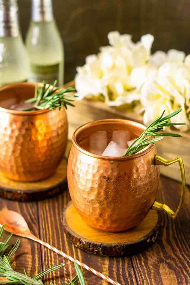 A side view of the bourbon mule with white flowers behind it.
