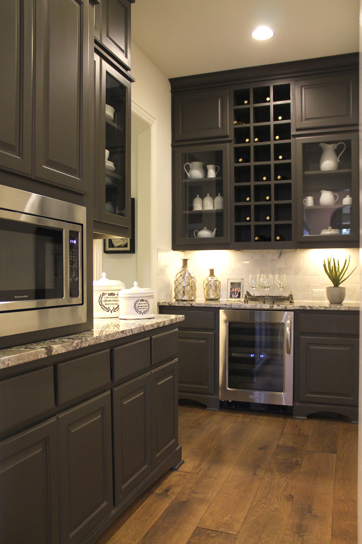 large pantry with cabinets  wine storage and glass doors