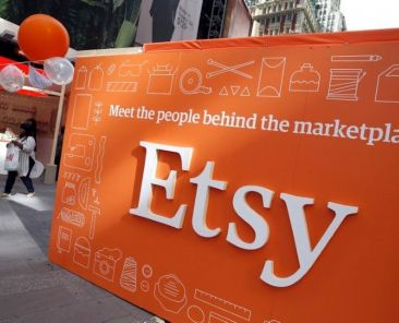 FILE PHOTO - A sign advertising the online seller Etsy Inc. is seen outside the Nasdaq market site in Times Square following Etsy's initial public offering (IPO) on the Nasdaq in New York April 16, 2015. REUTERS/Mike Segar/File Photo