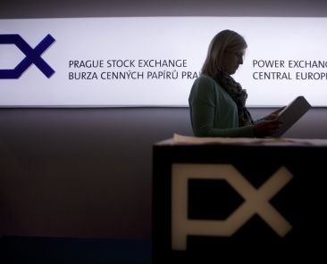 A logo sits illuminated in the reception area at the offices of the Prague stock exchange in Prague, Czech Republic, on Monday, May 27, 2013. Czech policy makers are in uncharted territory as they debate whether the first koruna sales in a decade are needed to meet their inflation target as the economy has shrunk for five quarters, the longest contraction since at least 1996. Photographer: Martin Divisek/Bloomberg
