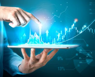 Digital marketing of sales and economic growth graph chart. Businessman hand holding tablet and point to chart on virtual screen. Business strategy Abstract graphic background