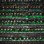 Cryptocurrency mining rigs at a Bitfarms facility in Saint-Hyacinthe, Quebec. Photographer: James MacDonald/Bloomberg