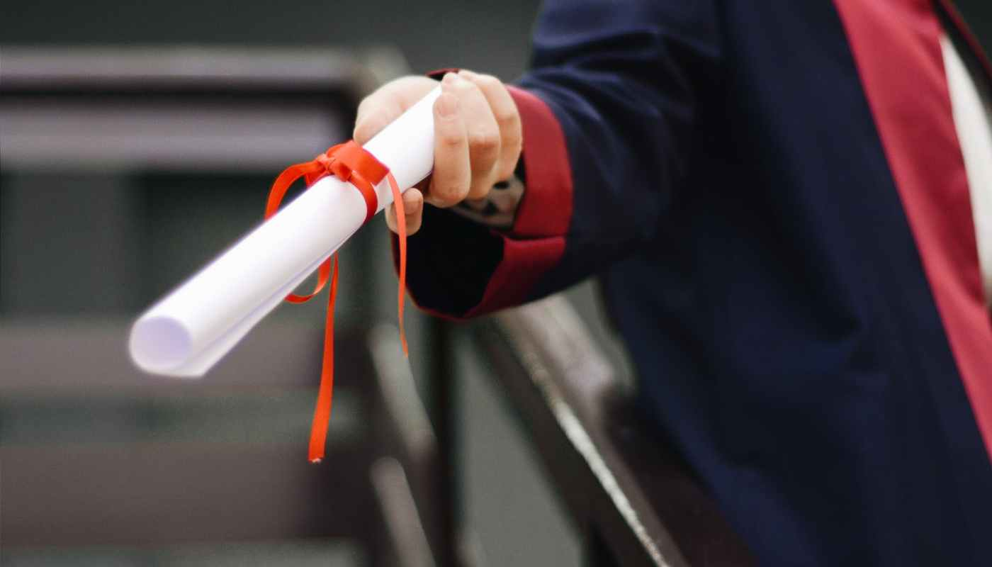 person holding white scroll
