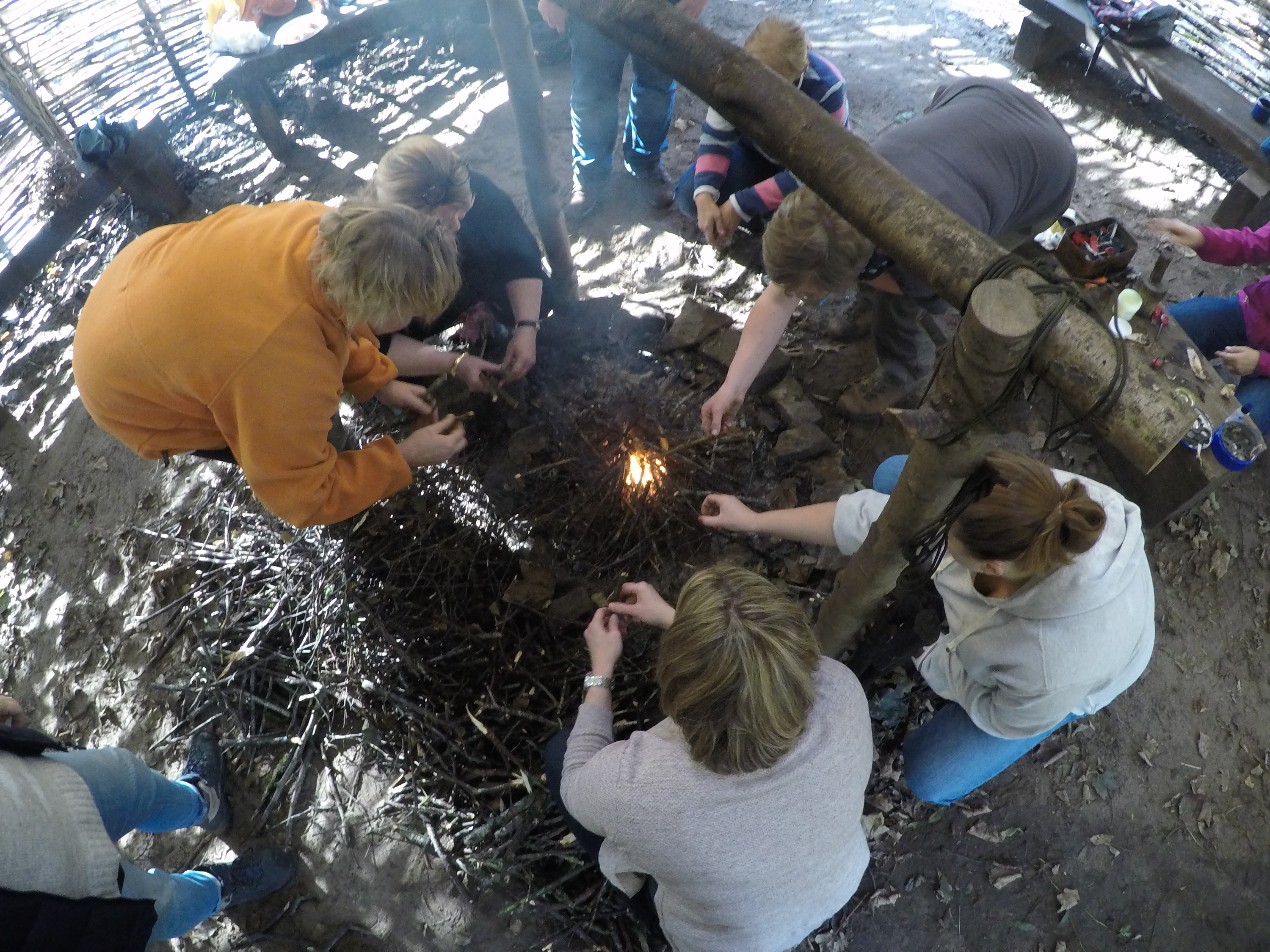 Working as a team to light the campfire