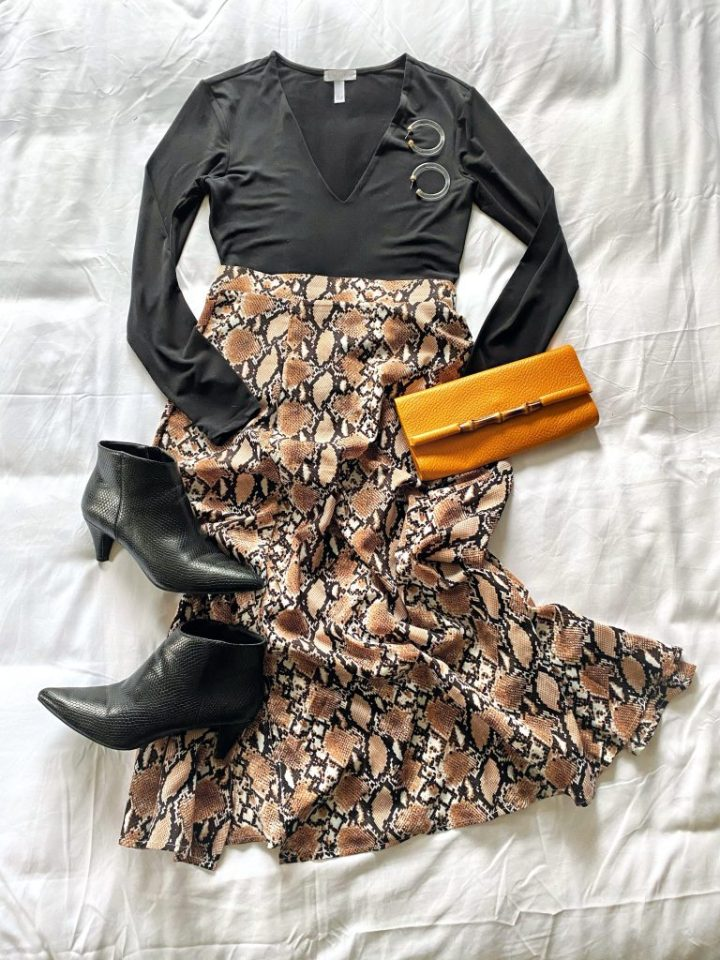 Date night outfit: snakeskin print midi skirt, bodysuit, black booties, clutch and hoop earrings.