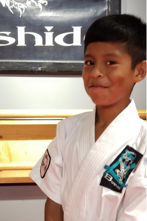 picture of boy in karate uniform