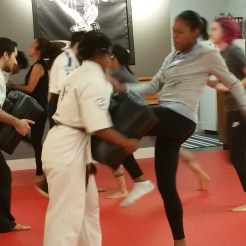 women in self defense class