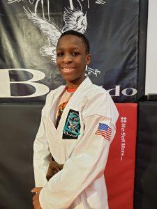 teen in karate gi