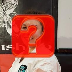 female martial artists hidden by question mark