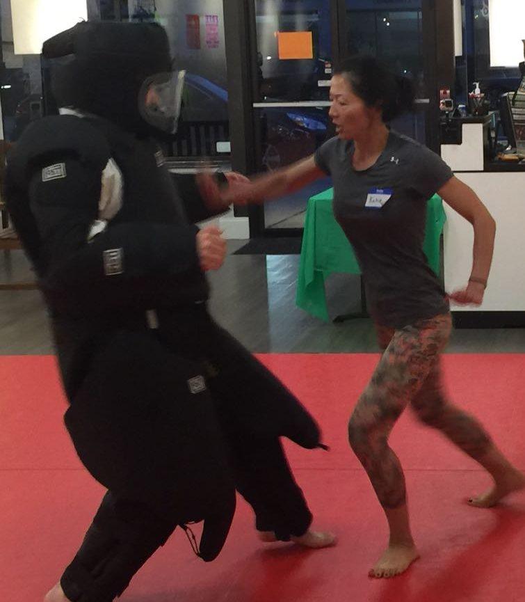 woman hitting attacker in self defense class