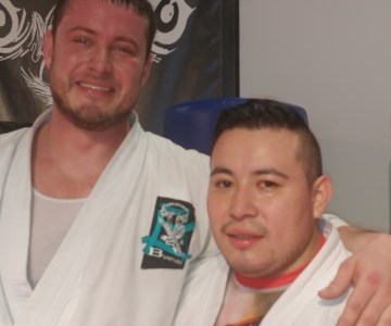 adult male karate students smiling
