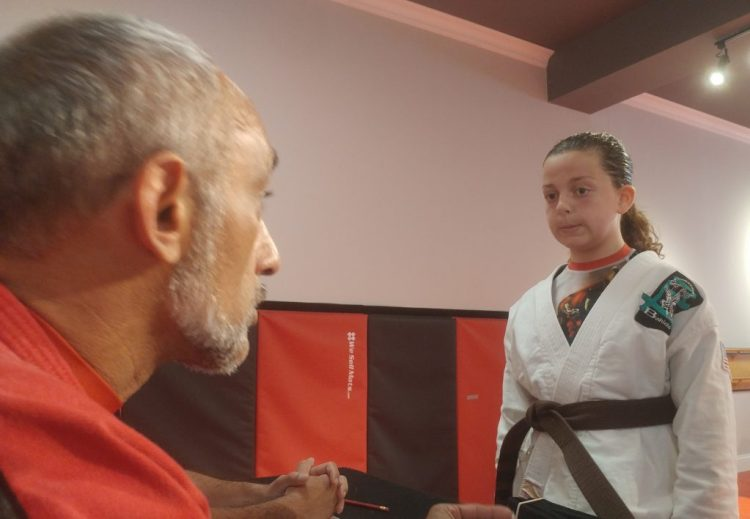 girl participating in private karate lesson