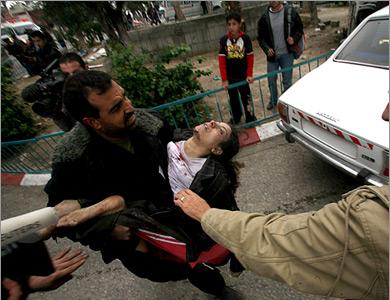 Gazan woman carried