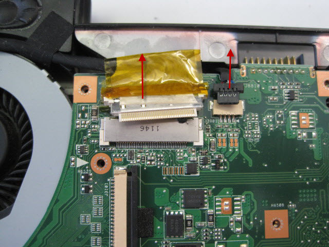 Gently pull the monitor and speaker cables out of the motherboard in the direction show. There are no retaining clips but there is tape holding the monitor cable in place.