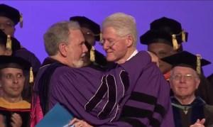 New York University President John Sexton greets former U.S. President Bill Clinton at the NYU Abu Dhabi 2014 commencement ceremony