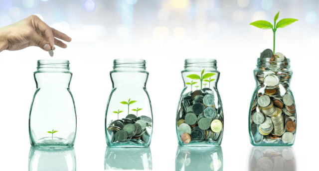 coins in jars with plants