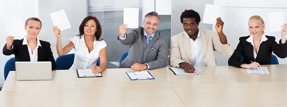 Group Of Happy Corporate Personnel Officers Holding Blank Paper