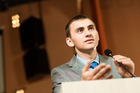 male speaker at podium