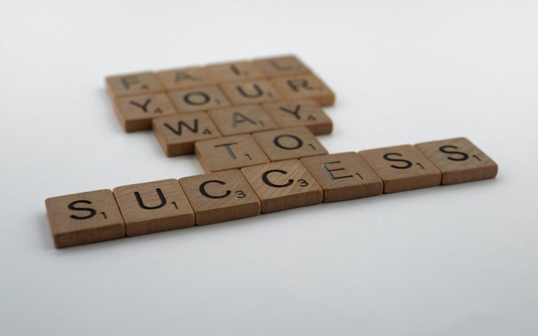 Scrabble tiles saying Fail Your Way to Success - showing the importance of failure