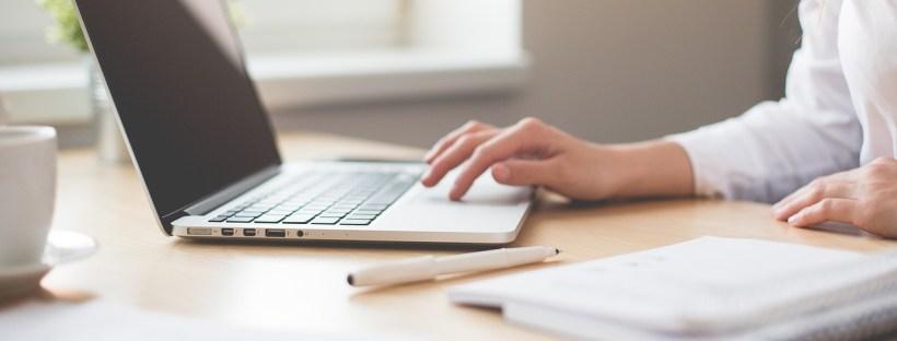 Ladies hand on laptop